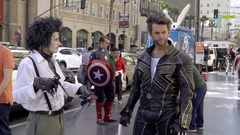 Edward Scissorhands hanging out with Wolverine on Walk of Fame in Hollywood LA Stock Footage