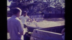 1977: two men stand around their vehicles on a sunny day LAKE ELSINORE Stock Footage