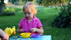 Happy cute kid playing Stock Footage