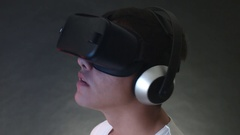 Smiling Young Man Wearing VR Headset And Experiencing Virtual Reality Stock Footage