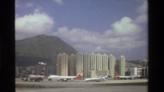 1984: a grouping of tall high rise building sit in front of a mountain SINGAPORE Stock Footage