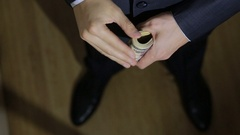 Male businessman finds a wad of money, dollars Stock Footage