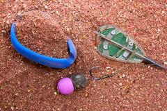 Dry feed for carp fishing as background. Ready for use Carp bait with fishi.. Stock Photos