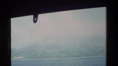 1984: the camera pans in on a mountain shrouded in fog HONG KONG Stock Footage
