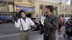 Wolverine and Edward Scissorhands hanging out Hollywood Boulevard Walk of Fame Stock Footage