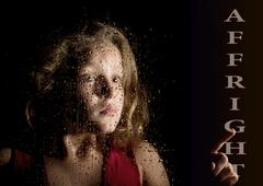 Affright written on virtual screen. hand of frightened young girl melancholy and Stock Photos
