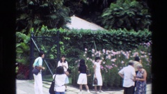 1984: a group of people gathered at an orchid enclosure SINGAPORE Stock Footage
