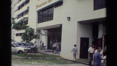 1984: people walking past a hospital or restaurant SINGAPORE Stock Footage