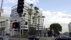La Brea Ave sign on Hollywood Boulevard tilting down cars driving LA Stock Footage