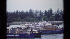 1984: boats of various side floating gently down a calm river SINGAPORE Stock Footage