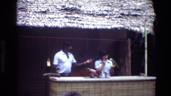 1984: two people are playing with tropical birds for tourists SINGAPORE Stock Footage
