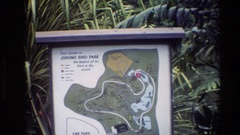 1984: a large banner with lots of greenery behind showing the directions  Stock Footage