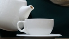 Woman pouring tea into cup Stock Footage