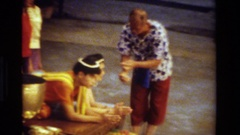 1984: group of people dressed in traditional clothing take part in a ceremony Stock Footage