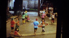 1984: using large bamboo sticks, native dancers perform for a crowd THAILAND Stock Footage