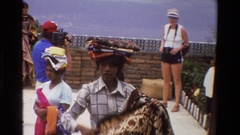1984: natives hawk rugs and cloth products to tourists on a mountain overlook Stock Footage