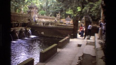 1984: water flowing in full force in a dam as people walk in to watch SINGAPORE Stock Footage