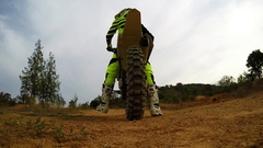 Slow motion start of motocross bike with many dirt from under the wheel. Stock Footage