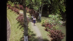 1984: two people walking a path through a park SINGAPORE Stock Footage