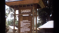 1984: signs beckon visitors' attention at indonesia's sangeh monkey forest Stock Footage