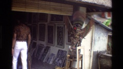 1984: a man enters an art studio in a garage Stock Footage