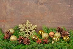Star anise, nuts, cones, Christmas decorations and spruse branch Stock Photos