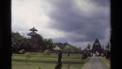 1984: stone religious statues stand on pedestals in east asia SINGAPORE Stock Footage