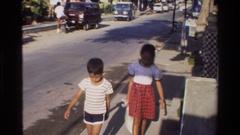 1984: families walking down the sidewalk SINGAPORE Stock Footage