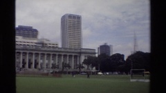 1984: a numerous city with fantastic buildings and widespread grasslands Stock Footage
