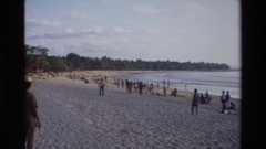 1984: number of people are passing their time near the beach SINGAPORE Stock Footage
