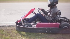 Go-kart track. Kart starts moving and slowly accelerates Stock Footage