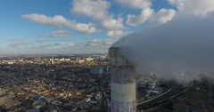 Aerial view of smoke pipe against backdrop of old industrial area of city Stock Footage