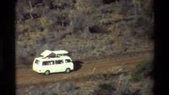 1983: a white safari van taking tourists on a trip through the grasslands Stock Footage