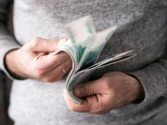 Hands counting rubles Stock Photos