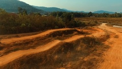 Aerial: Slow motion jumping on motocross bike. Stock Footage