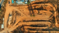 Aerial: Birds eye view of a motocross man on the track. Stock Footage