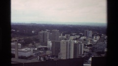 1983: aerial of city blocks downtown with multi-story buildings, industrial Stock Footage