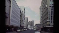 1983: street scene of people and cars NAIROBI KENYA Stock Footage