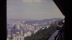 1984: a person in a striped shirt looks out over a city from a high vantage  Stock Footage