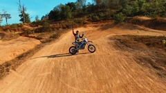 Aerial: Man has won a championship in motocross. Stock Footage