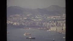 1984: looking out over large city and ships in the bay HONG KONG Stock Footage