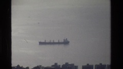 1984: a solitary ship floats in the sea on a cloudy day HONG KONG Stock Footage