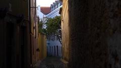 Saint George Castle typical street sight -  Alfama -  Lisboa, Portugal Stock Footage
