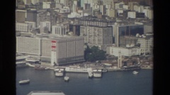 1984: a two story oval structure sits on top of two wide pillars HONG KONG Stock Footage