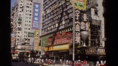 1984: a panoramic view of a city that has a lot of hustle and bustle going on  Stock Footage