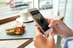 Hands with smartphone photographing food Stock Photos
