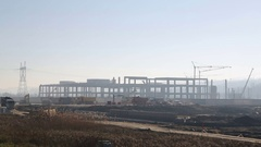 The silhouette of a large construction site early in the morning, wide angle Stock Footage