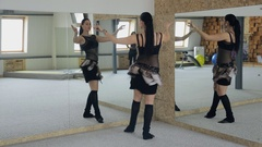 Charming brunette practices belly dance in front of mirror Stock Footage