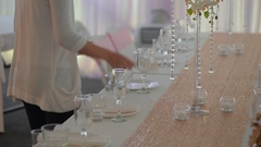 Waitress setting up a table at wedding reception Stock Footage