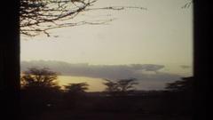 1983: watching beautiful clouds MARA TANZANIA Stock Footage